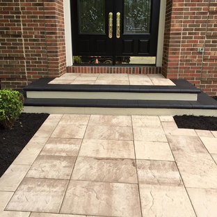 Design ideas for a mid-sized modern partial sun front yard concrete paver landscaping in DC Metro.
