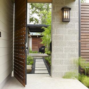 Ejemplo de jardín asiático con adoquines de hormigón