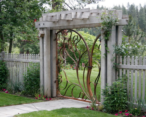 Garden Gate Ideas raised bed vegetable herbs garden fenced gate stone pebble walkway protection from pest Main Entrance Gate Home Design Ideas Pictures Remodel And Decor Garden Gate Designs