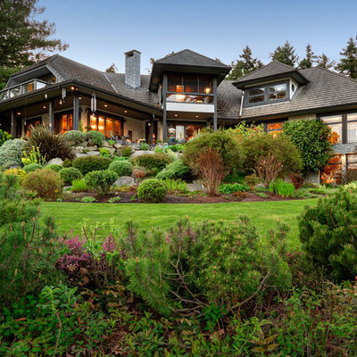 Photo of a traditional backyard landscaping in Vancouver.