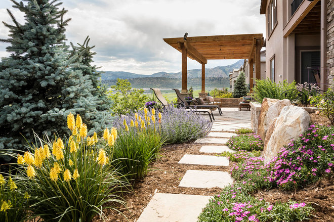 Traditional Landscape by C&H Landscaping