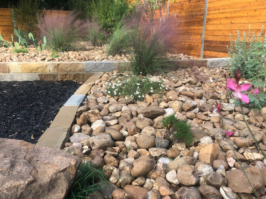 Combination of Mulch, Sandstone beds w/ Colorado River Rock