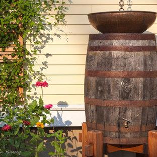 Design ideas for a small farmhouse full sun side yard water fountain landscape in Boston for summer.