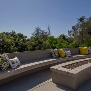 Inspiration for a large contemporary full sun backyard concrete paver landscaping in San Diego with a fire pit for summer.