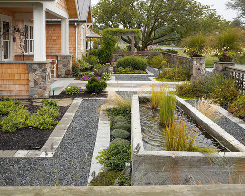 Country italian courtyard hardscape with fountain home for Courtyard landscaping ottawa
