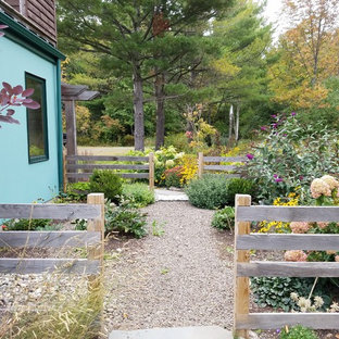 This is an example of a large asian drought-tolerant and partial sun backyard stone garden path in New York.