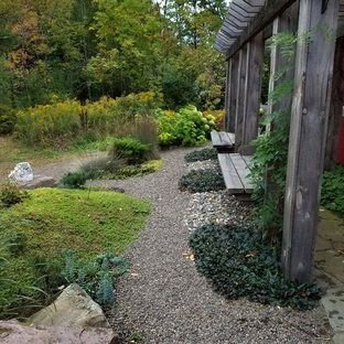Inspiration for a large asian drought-tolerant and partial sun backyard stone garden path in New York.
