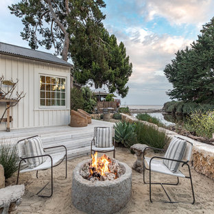 Inspiration for a mid-sized beach style full sun backyard landscaping in San Luis Obispo with a fire pit for summer.