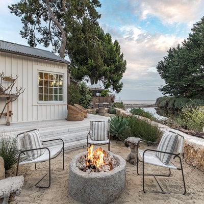 Inspiration for a mid-sized coastal full sun backyard landscaping in San Luis Obispo with a fire pit for summer.