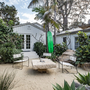 Design ideas for a mid-sized beach style full sun backyard landscaping in San Luis Obispo for summer.