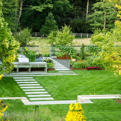 This is an example of a mid-sized contemporary partial sun backyard stone formal garden in New York.