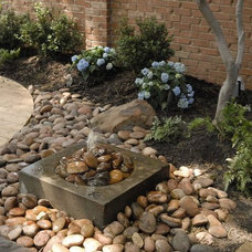 Traditional Landscape by Alford's Landscaping