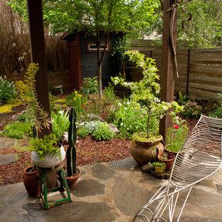 Design ideas for an asian backyard garden in Atlanta with natural stone pavers.