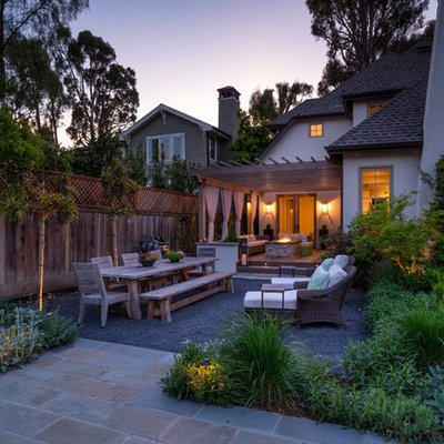 This is an example of a mid-sized contemporary partial sun backyard stone formal garden in San Francisco for spring.
