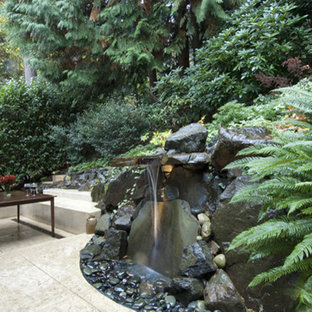 Inspiration for a large modern partial sun backyard concrete paver formal garden in Seattle.