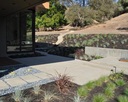 Paver patio steps rock retaining slope houzz for Plusen landscape architects