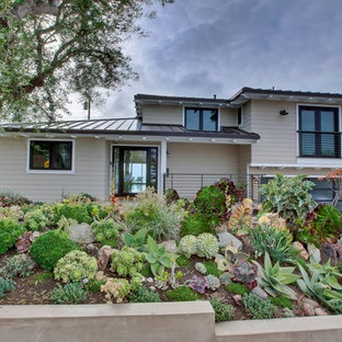 This is an example of a contemporary front yard full sun xeriscape in Los Angeles.