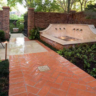 Design ideas for a small traditional shade courtyard brick water fountain landscape in Houston for fall.