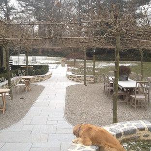 Inspiration for a large traditional full sun backyard stone formal garden in Philadelphia for winter.