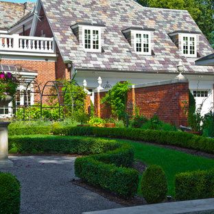 Design ideas for a huge traditional full sun courtyard gravel landscaping in New York for spring.
