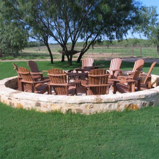 Design ideas for a large rustic full sun backyard mulch landscaping in Austin with a fire pit.