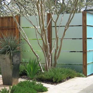 Idee per un giardino contemporaneo con pavimentazioni in pietra naturale