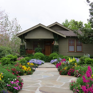 Photo of a craftsman drought-tolerant and full sun front yard stone landscaping in Houston.