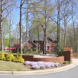 This is an example of a large traditional partial sun front yard landscaping in Atlanta for winter.
