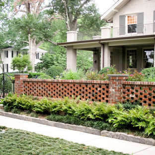 Inspiration for a mid-sized traditional front yard brick landscaping in Other.