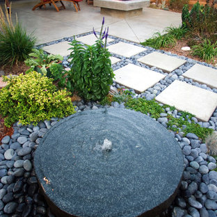 Inspiration for a contemporary water fountain landscape in Denver.