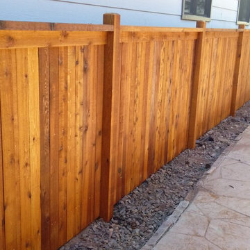 Custom cedar fence stained with Sikkens Natural