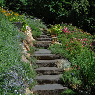 Mid-sized traditional sloped full sun formal garden in New York with a garden path and natural stone pavers for summer.