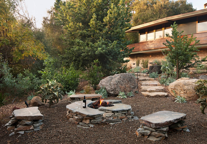 Rustic Landscape by Projects General Construction, Inc