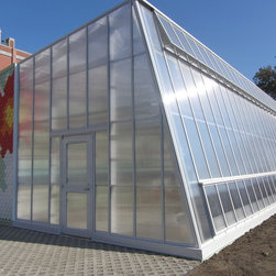 Custom Greenhouses - This greenhouse was manufactured for PS 216 in Brooklyn, NY as part of The Edible Schoolyard project.  Designed by WorkAC, this greenhouse capitalizes on solar gain with a unique reverse slope.