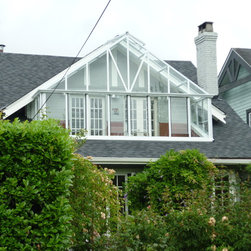 Custom Greenhouses - This customer had a unique project for our retailer - to design and manufacture a patio cover for an existing second floor deck.  Great care was given to weight loads and wind requirements.  Now the space which previously was unused has become one of the most used rooms in the house.