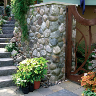 This is an example of a mid-sized transitional front yard stone garden path in Minneapolis.
