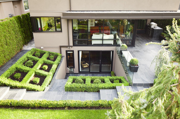 Modern Landscape by Natural Balance Home Builders