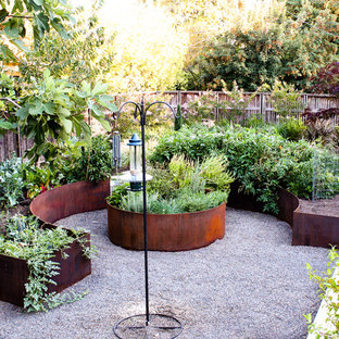 Design ideas for a large mediterranean partial sun backyard gravel vegetable garden landscape in Portland.
