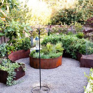 Design ideas for a large mediterranean partial sun backyard gravel vegetable garden landscape in Portland.
