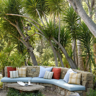 Inspiration for a mid-sized tropical partial sun backyard gravel landscaping in Santa Barbara.