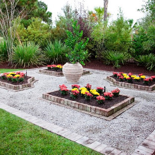 Design ideas for a tropical backyard brick formal garden in Charleston for summer.