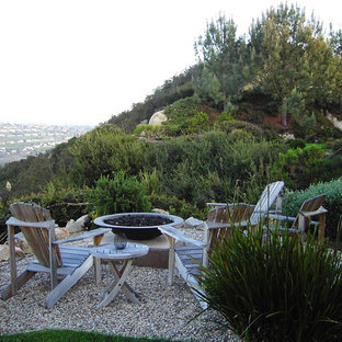 This is an example of a rustic landscaping in San Diego with a fire pit.