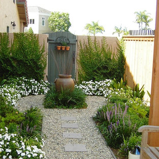 Small mediterranean side yard formal garden in San Diego.