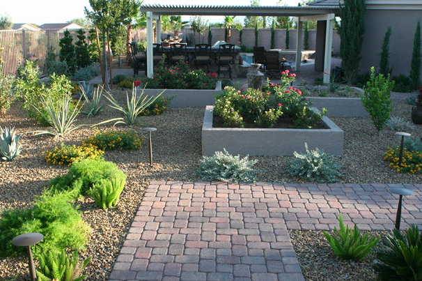 Traditional Landscape by Green Planet Landscaping Pools & Spa
