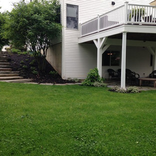 This is an example of a small contemporary hillside landscaping in New York.