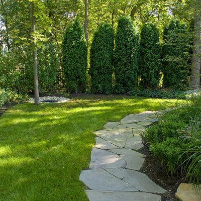 Inspiration for a traditional shade backyard stone garden path in Chicago.