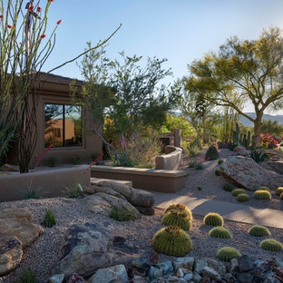 Design ideas for a mid-sized southwestern drought-tolerant and desert front yard gravel landscaping in Phoenix.