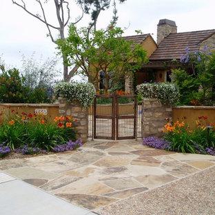 Photo of a mediterranean front yard stone garden path in San Diego.