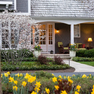 Inspiration for a large transitional partial sun front yard stone landscaping in Chicago for spring.