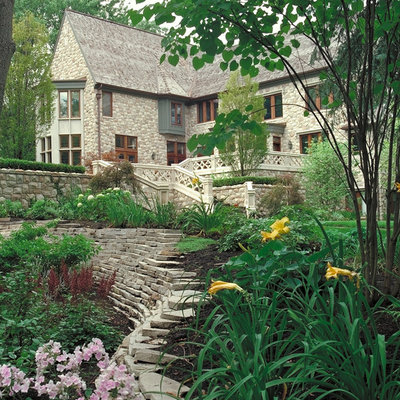 Photo of a large traditional shade hillside formal garden in Detroit.